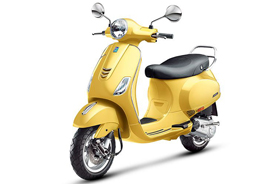 Yellow Vespa scooter rental