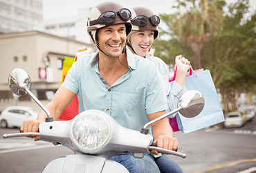 Man and woman shopping in Miami Beach with scooter rental